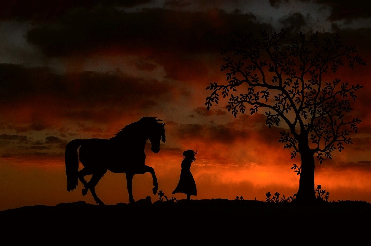 a girl and a horse at sunset.jpg