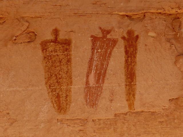 Three small figures near Flying Carpet