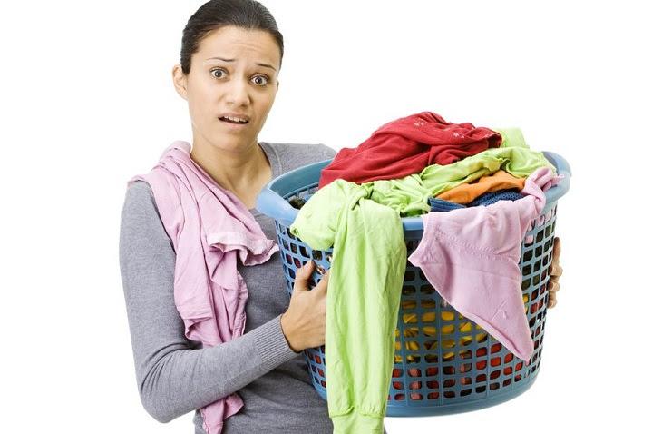 Bỏ thêm quần áo khi máy giặt cửa trước đang hoạt động có được không?