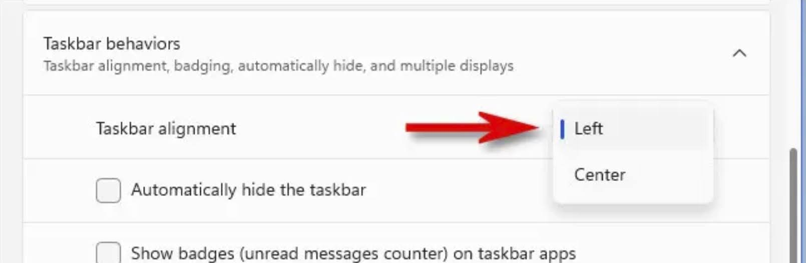 Select the Left option from the drop-down menu next to the Taskbar Alignment option. This will change the alignment of the taskbar from the default center to the left of the screen.
