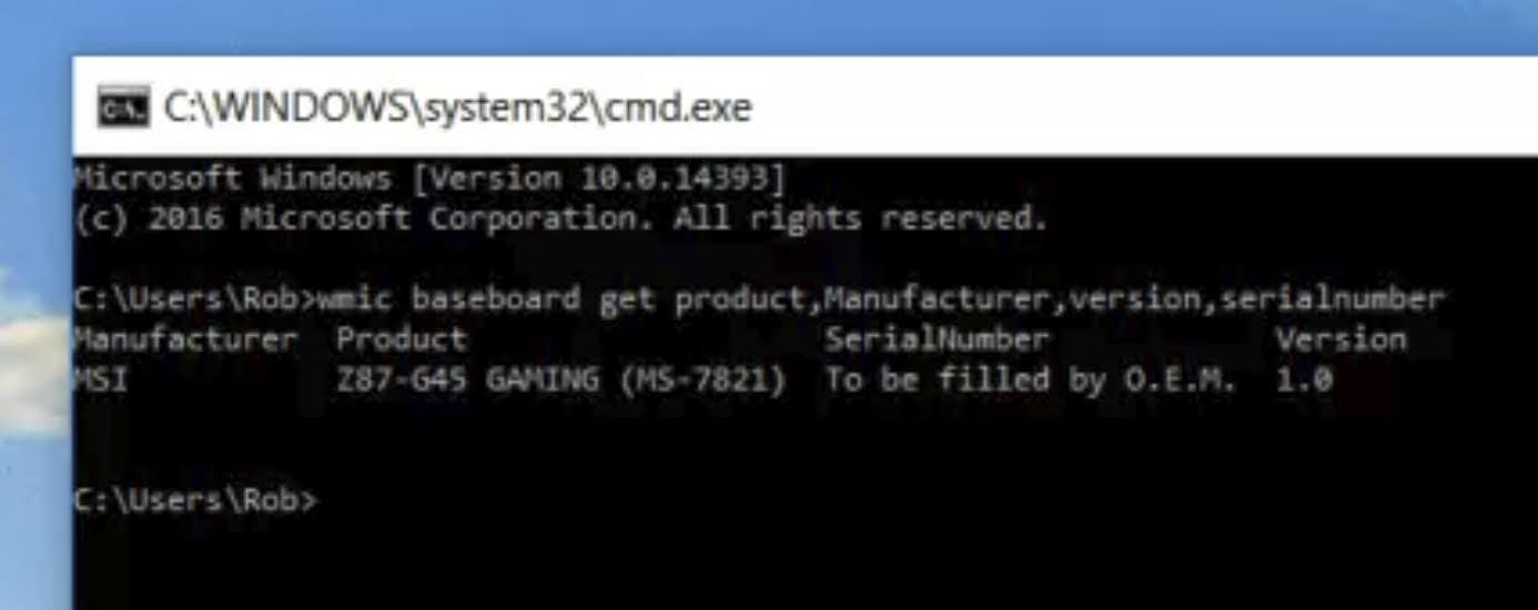 wmic baseboard get product,manufacturer,version,serialnumber command will display the motherboard manufacturer, model number, version, and the serial number if available.