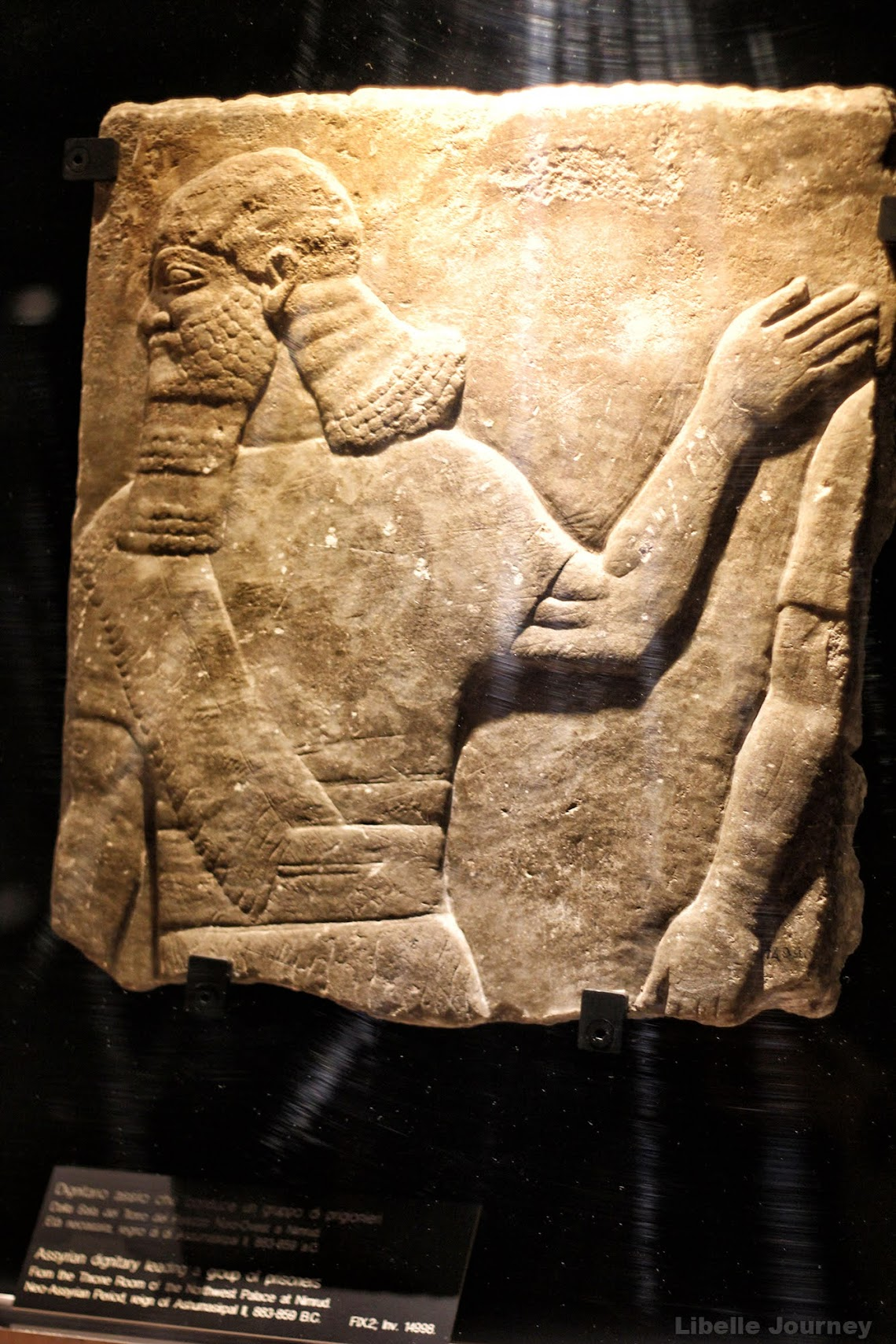 assyrian dignitary leading a group of prisoners