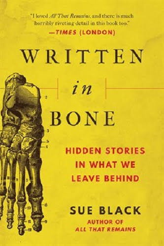 yellow book cover with skeleton hand on the cover
