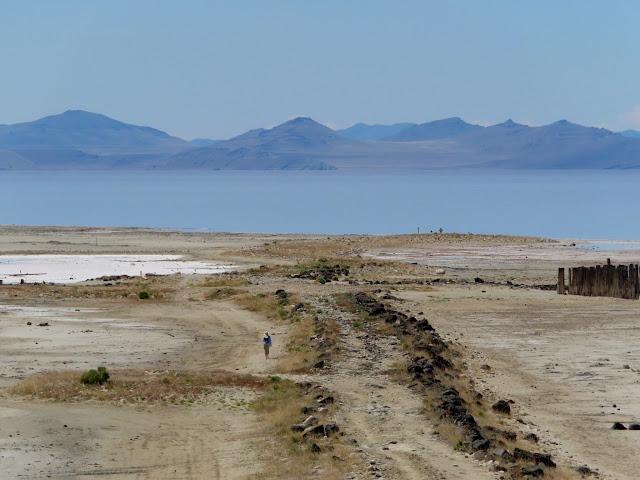 Woman walking along a jetty near Spiral Jetty