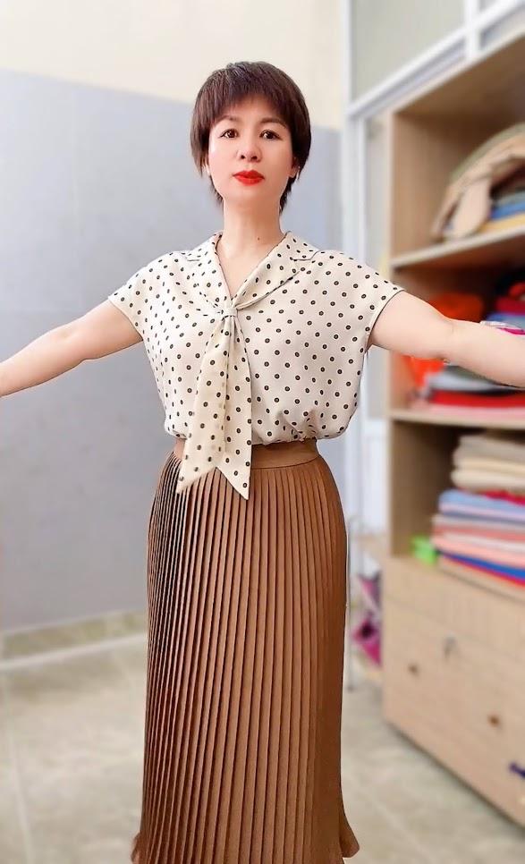 Áo sơ mi nữ cổ nơ và chân váy xòe midi xếp ly V765 thời trang thủy sài gòn