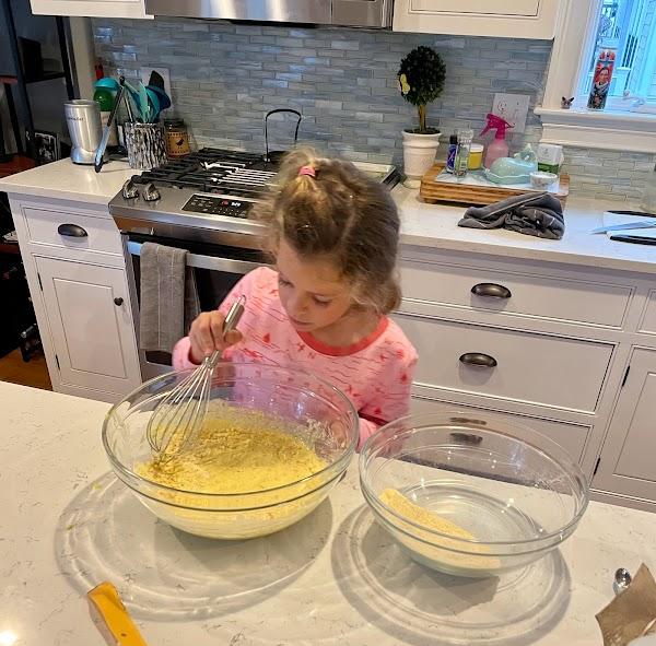 Vivian helping make cornbread
