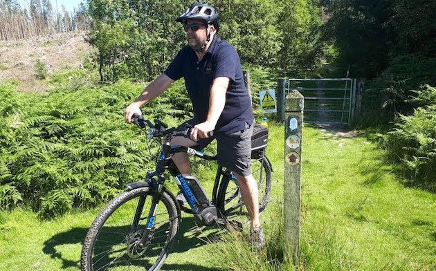 e-bikers inspecting pathways