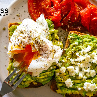 Avocado and Egg Open-Faced Sandwich with Roasted Tomatoes.
