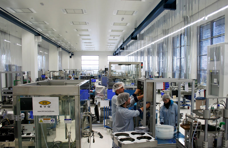 Photo: EVG's class 100K clean manufacturing in action.