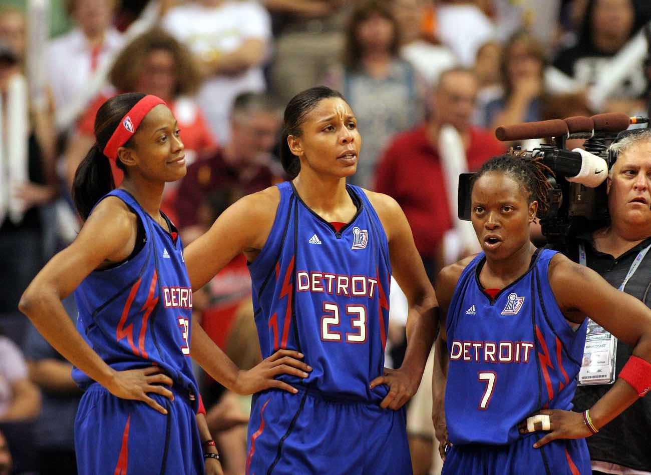 PHOENIX - SEPTEMBER 11: Detroit Shock players Swin Cash #32, Plenette Pierson #23 and Shannon Johnson #7 stand on the sideline against the Phoenix Mercury in Game 3 of the WNBA Finals on September 11, 2007 at US Airways Center in Phoenix, Arizona. Detroit won 88-83 to take a 2-1 lead in the series. (Photo by Domenic Centofanti/Getty Images)