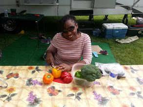 Photo: Shawnice cutting veggies for dinner