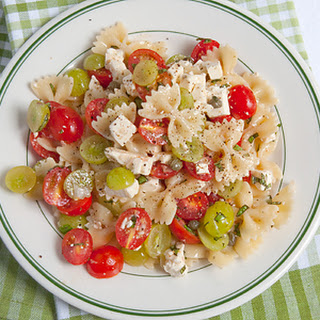Bow Tie Pasta Salad with Tomatoes and Grapes.
