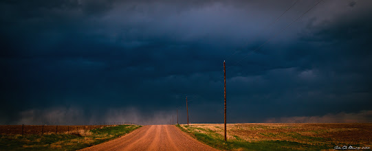 """Photo: """"The Race To The Storm"""" Photo thoughts--- I can't leave well alone enough with not posting more photographs from this past Wednesday's storm chase on the eastern plains of Colorado! Sometimes you don't have time to stop to get the shot with storm chasing for your target with an intercept to get close to the action is top priority and as we started to crest a hill on a country dirt road in """"bfe"""" Washington county, Colorado I fired off a few shots through the windshield hoping my polarizer would kill the glare get what I was after. I think I got what I was after! It is like the road that leads you into the mouth of hell and boy, it delivered the goods! ---John  #skysunday #cowx #nature #travel #naturephotography #landscape  #landscapephoto #landscapephotography #colorado #weather #weatherphotos #cloud #rural #countrysunday #country #sky #cloudphotos #exposedphoto #plusphotoextract #photoplusextract #photography #photo"""