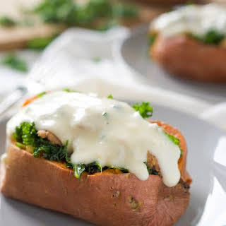 {20 minute} Kale and Sausage Stuffed Sweet Potatoes with White Cheese Sauce.