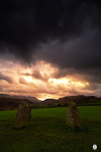 Photo: Gateway To The Storm  Through standing stones Of times long gone The storms still rage To greet the solitude upon the hills And we stand within the gateway Built by forefathers long since past Do we see what they see? Do we feel what they felt? Is the myth and magic still within our souls? At the gateway to the storm We become alive again Wrapped within the myth Carried upon the magic We still see We still feel