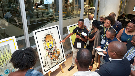 Puleng Mokagane, telling the story of his winning piece, 'The Prophet of the Masai', commissioned by Telkom. (Photo: PaulMcGavin)