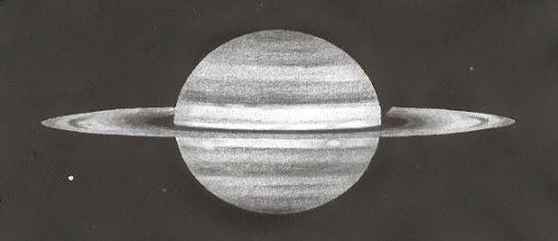 Photo: Saturne le 13 avril 2009 à 21H58TU. T406 à 500X en bino, images stables. Spots clairs sous l'anneau, et satellites Rhéa.