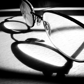 Glasses on a bench by Jim Moran - Abstract Light Painting ( glasses, bench, summer, strong., sun, black )