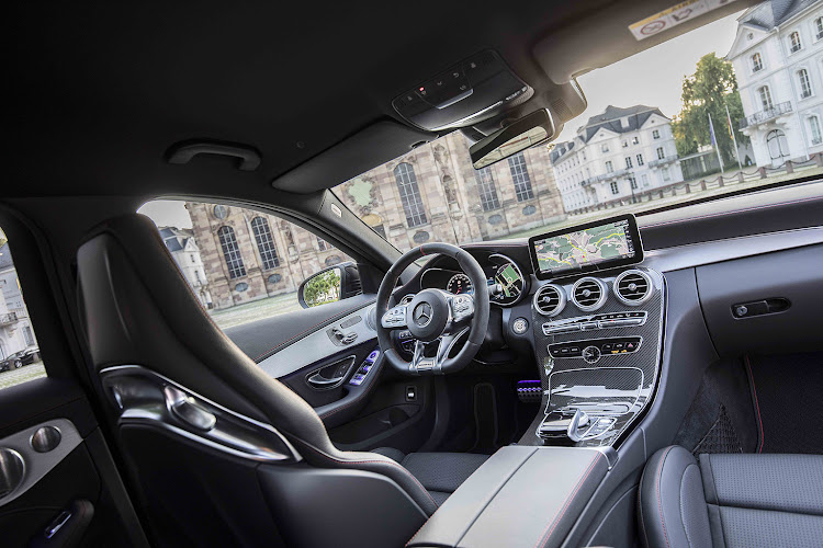 The interior still gets the AMG treatment to match that C-Class elegance.