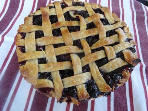 "Simple, Very Blueberry Flavored Pie ""One bite of this scrumptious pie, and..."