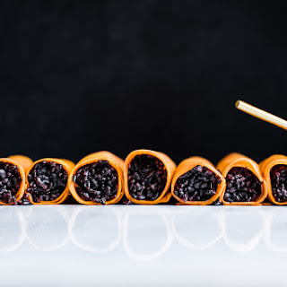 Sweet Potato Forbidden Rice Rolls with Ginger Miso Sauce.