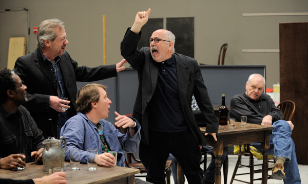 Photo: (Center) Hugo (Lee Wilkof) fires off to (left to right) Joe Mott (John Douglas Thompson), Harry Hope (Stephen Ouimette), Willie Oban (John Hoogenakker), and Larry Slade (Brian Dennehy) during a rehearsal of Eugene O'Neill's The Iceman Cometh, directed by Robert Falls, at Goodman Theatre (April 21 – June 17).