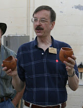 Photo: Gary Guenther brought two wormy dogwood cups from the same branch -- one turned end grain and one turned side grain (a so-called bird's mouth double bullseye)