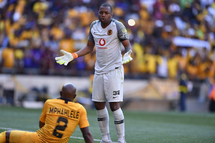 Itumeleng Khune argues with Ramahlwe Mphahlele of Kaizer Chiefs during the Absa Premiership match between Orlando Pirates and Kaizer Chiefs at FNB Stadium on October 27, 2018 in Johannesburg, South Africa.