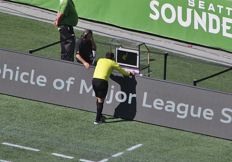 referee checking the video during a match VAR (What is Handball in Soccer?)