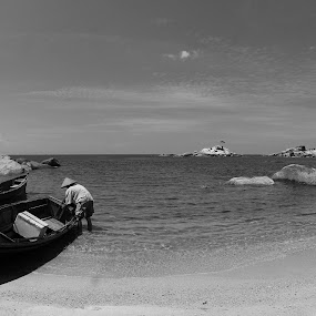 between by Gilang Franasia - Black & White Landscapes ( black and white, beach, fisherman, landscape, boat,  )