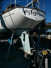 Photo: Tied the rudder to the boat so it will elevate and allow me to kick ot the support blocks as the boat is lifted.