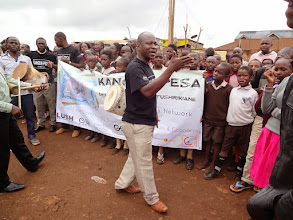 Photo: Teaching the Kangemi-Pesa marching song.