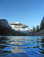 Photo: Water, sky and a cloud Taken at the Elbow river in Banff.