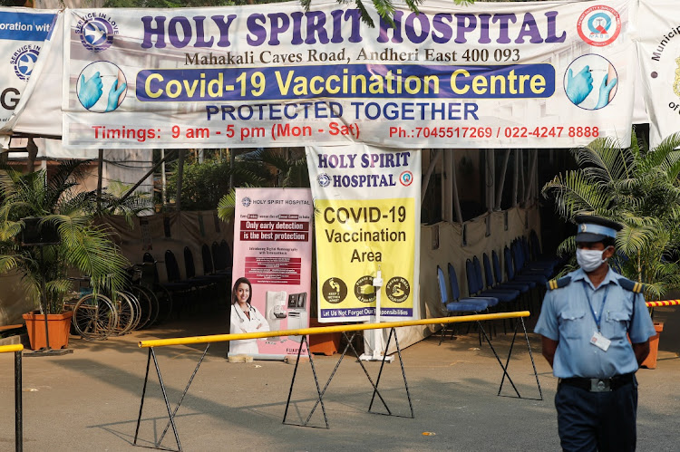 A private security guard stands outside an empty coronavirus disease (COVID-19) vaccination centre after Brihanmumbai Municipal Corporation (BMC) issued a notice about no vaccination for three days, in Mumbai, India on April 30 2021. Picture: REUTERS/FRANCIS MASCARENHAS