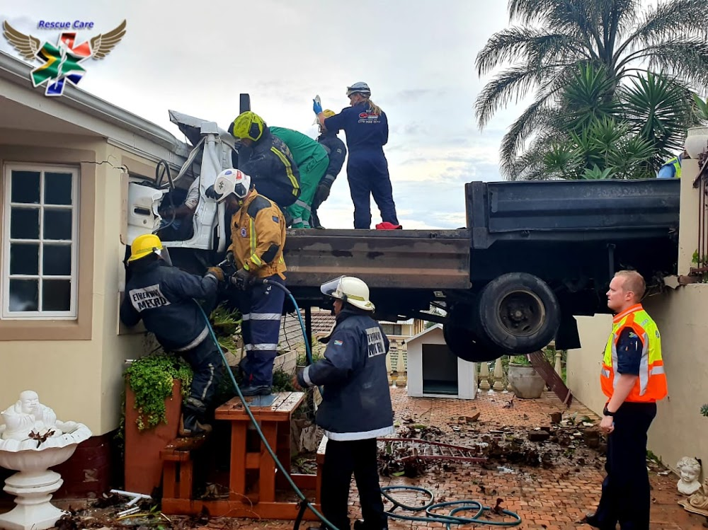 One dead, two trapped in mangled wreckage after truck crashes into Durban house - TimesLIVE