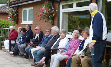 Photo: George & Lyn Mantle joins the spectators. Dave wants another pint!