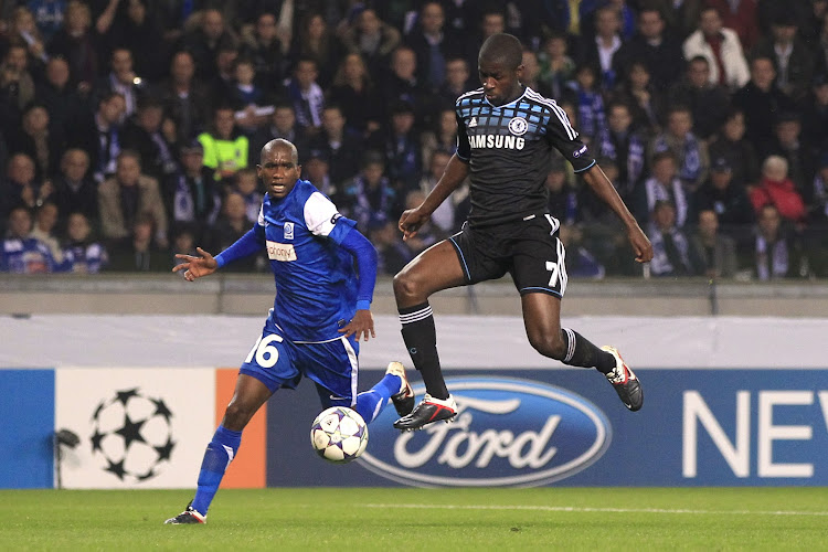 A file photo of Anele Ngcongca (L) during his time with Belgian giants KRC Genk challenging Chelsea's Ramirez during a Uefa Champions Legue match in Genk. Ngcongca played for Genk for nine seasons.
