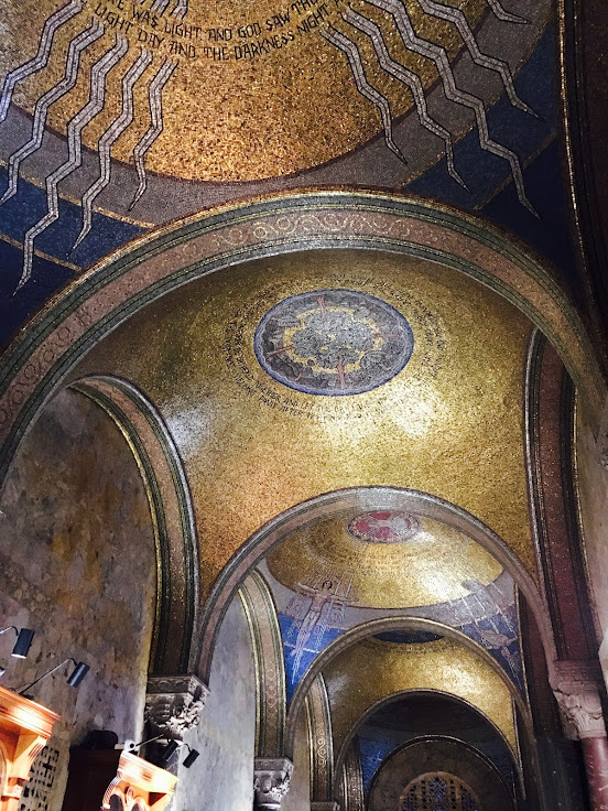 The mosaic domes on the ceiling before the nave.