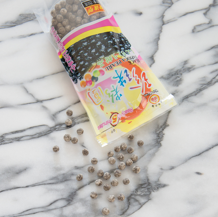 overhead photo of tapioca pearls spilling out of a bag