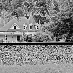 Across the tracks by Crystal Gibson - Buildings & Architecture Homes ( black and white, pwcbuilding )