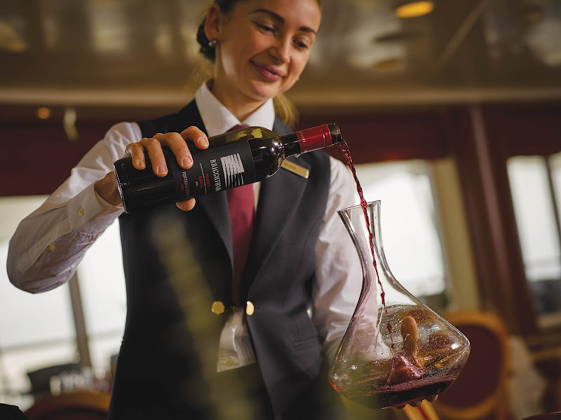 A sommelier decanting wine on a Sliversea voyage.