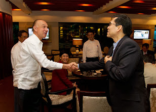 Photo: 22 August 2013 - Cocktails at the Dusit Thani Hotel in Makati.  Chairman Luis shaking hands with FINEX Board Member Benito Soliven II
