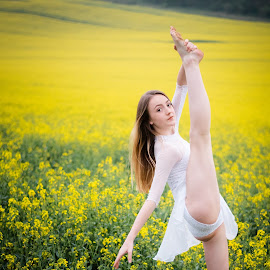 Dancing in gold by Vix Paine - Babies & Children Child Portraits ( beauty, dancers, pose, rapeseed field, dance photography, child dancer, dance move, yellow, ballet, bare feet, teenagers, flower, dancer, working together, gold, colour, rapeseed, family, child, teenager )