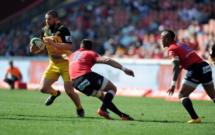 Harold Voster and Elton Jantjies of Lions in action with Dane Coles of Hurricane during the Super Rugby, Semi Final match between Emirates Lions and Hurricanes at Emirates Airline Park on July 29, 2017 in Johannesburg, South Africa.