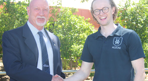 Deputy mayor Robert Kneale, left, welcomes Bush Bursary student Mitchell Morby.