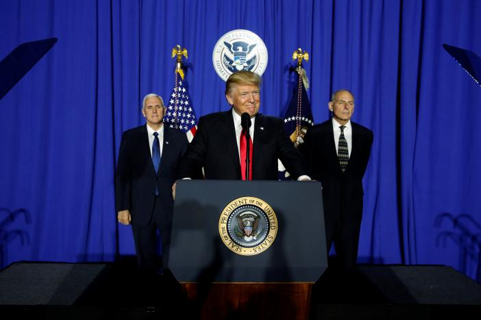 President Donald Trump (C), flanked by Vice President Mike Pence (L) and Homeland Security Secretary John Kelly (R). REUTERS