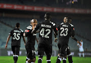 Augustine Mulenga of Orlando Pirates celebrates goal with teammates during the Absa Premiership match between Orlando Pirates and Bidvest Wits 25 April 2018 at Orlando Stadium.