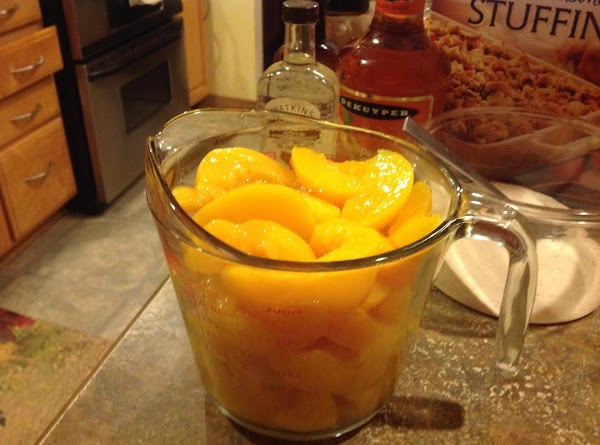 Measure out 4 cups of sliced peaches, but reserve liquid.