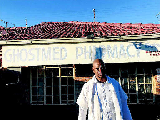 Moloko Mokoditoa stands in front of one of his closed pharmacies  in Atteridgeville,  Pretoria. / SUPPLIED