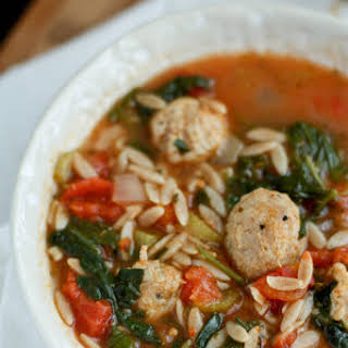Italian Orzo Soup with Sausage Meatballs, Spinach and Tomatoes.